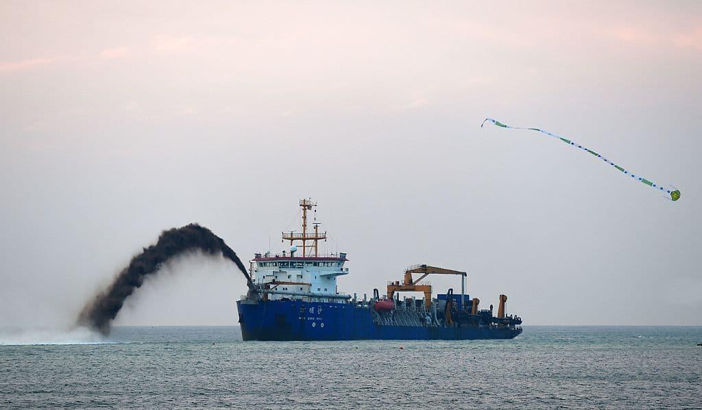dredger performing a survey using multibeam sonar